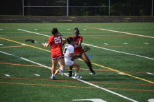Sophomore Defender Sarah Toth double teams the Hebron ball with help from her teammate for a Centennial turnover.