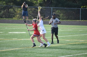 Senior Midfielder number 8, Claudia Pilcher moves to box out opponent while taking the draw to gain possession of the ball.