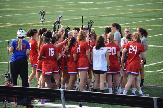 Centennial Girls Varsity Lacrosse team hypes up to take on the second half of their second playoff game at Mt. Hebron High School.