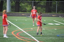 ​Junior Midfielder, Olivia Weakland prepares for a free shot at goal accompanied by teammates Junior, number 13 Kelly Peterson and Freshman, number 23 Nicole Ouellete.