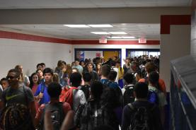 On the first day of school, the students are going to their next class as they walk through crowded hallways. -Olga Raymundo