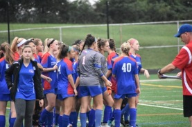 The girls' Varsity soccer team prepares to take the field for their game.